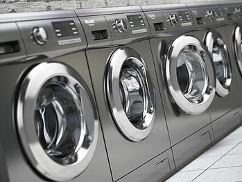 Row of Washing Machines in a Public Laundromat