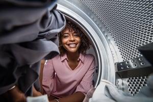 woman starting a laundromat